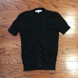 Short sleeved black cardigan.